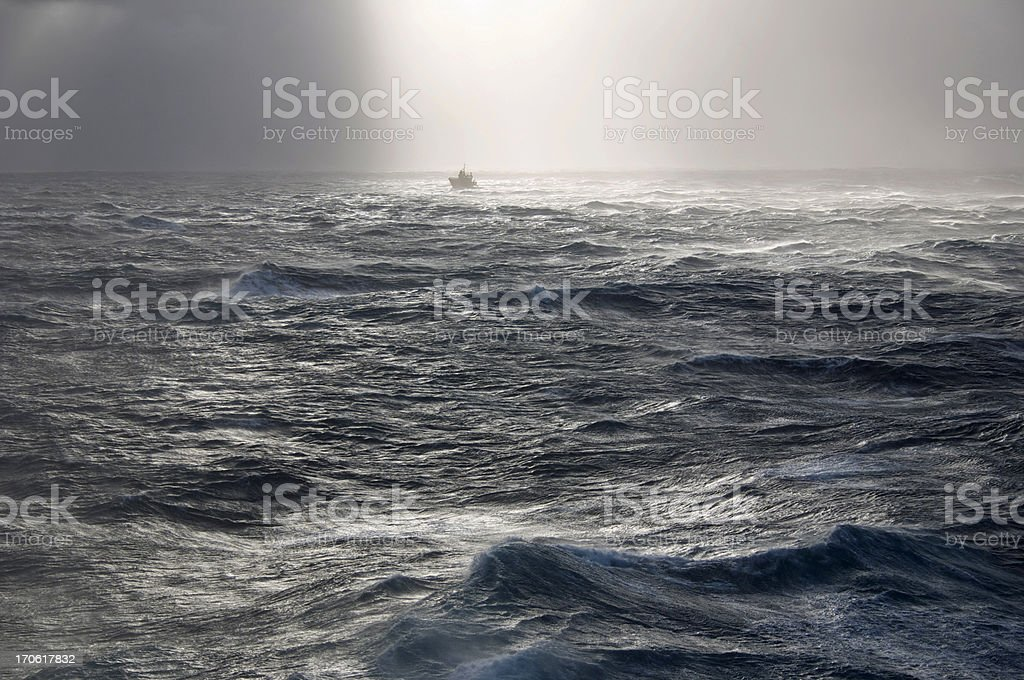 boat in storm at sea royalty-free stock photo