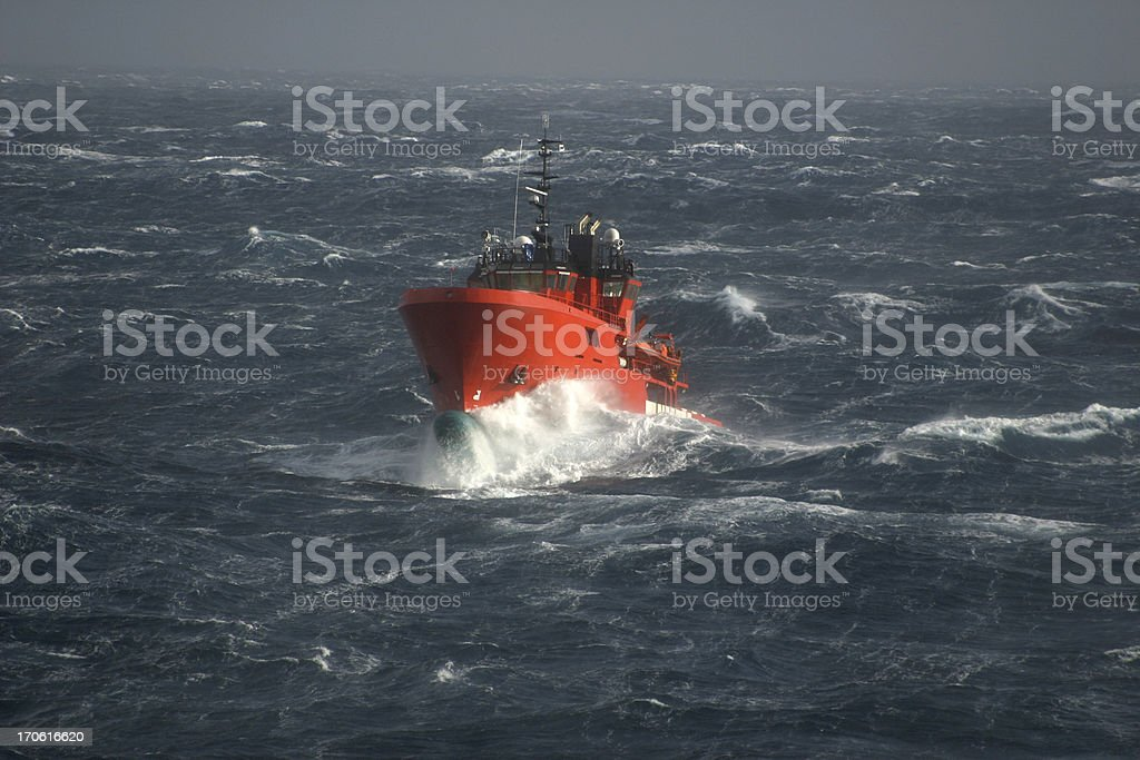 boat in stormy sea royalty-free stock photo