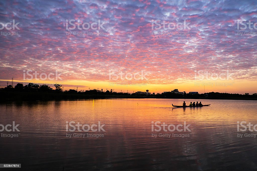 boat in sunset stock photo
