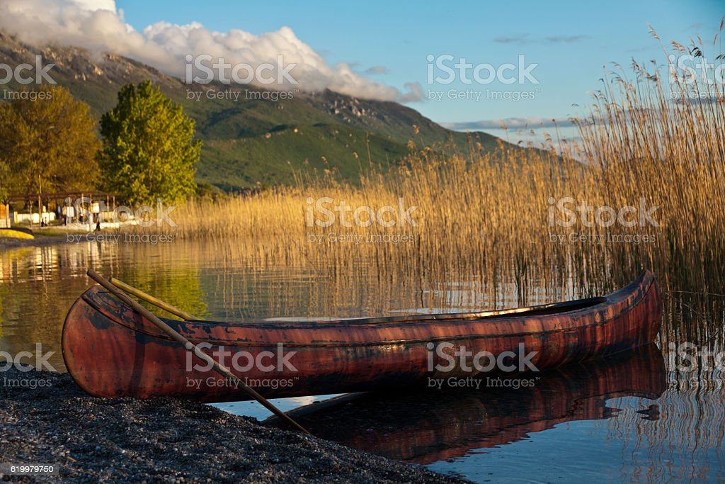 Boat in the beautiful lake Ohrid behind the reed stock photo