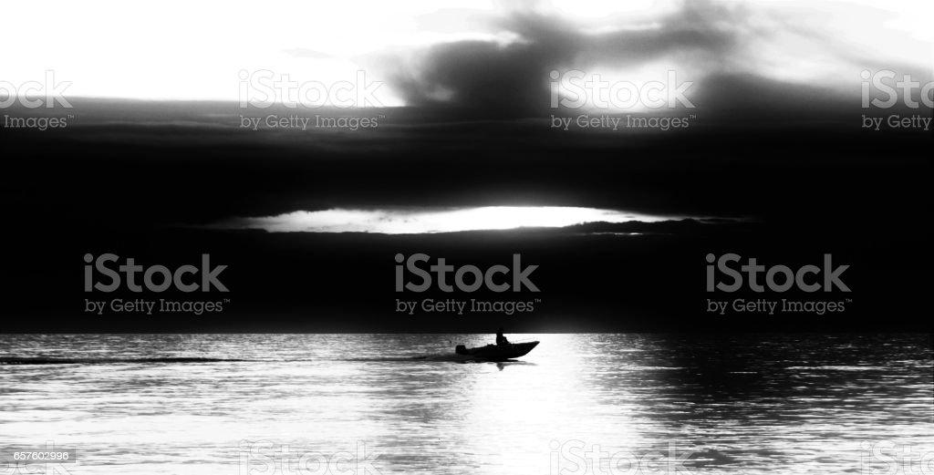 boat in the dark sea stock photo
