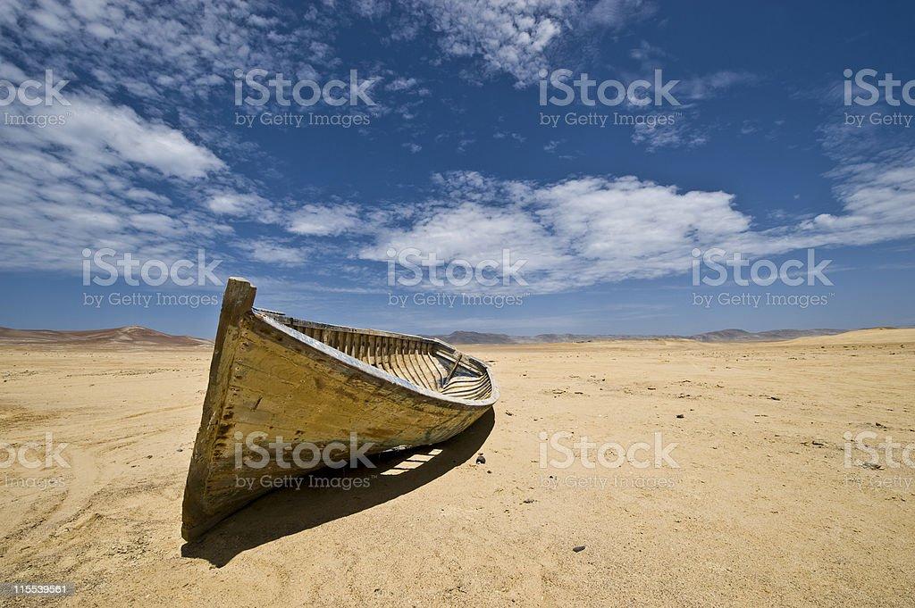 Boat in the desert stock photo