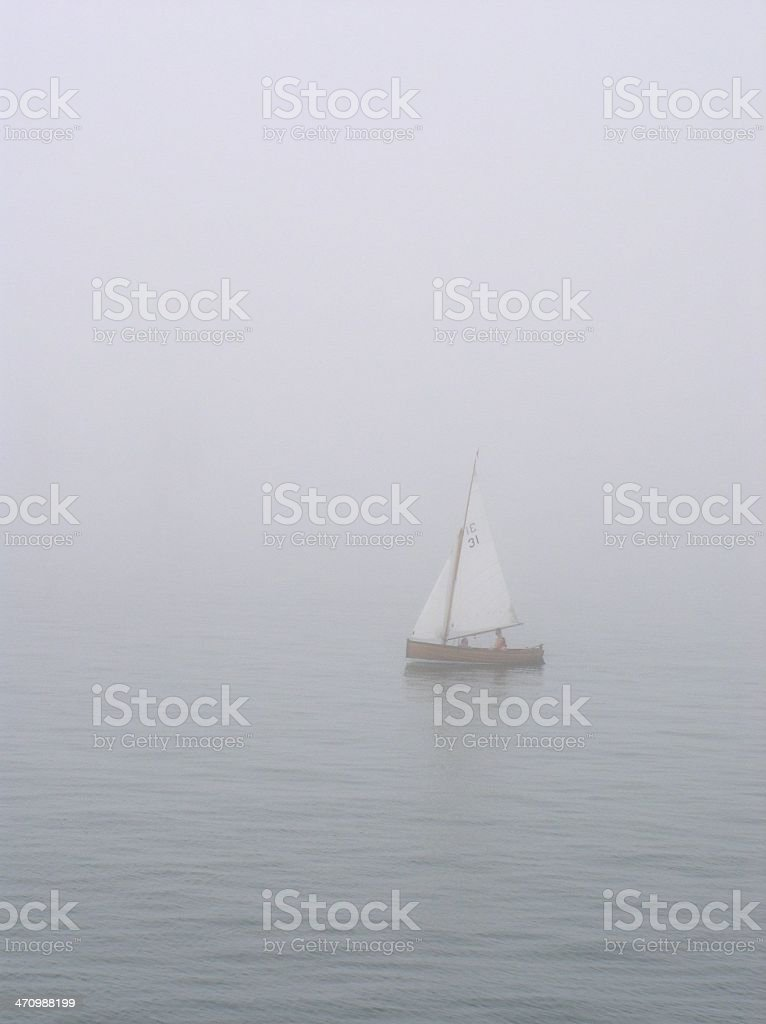 boat in the fog stock photo