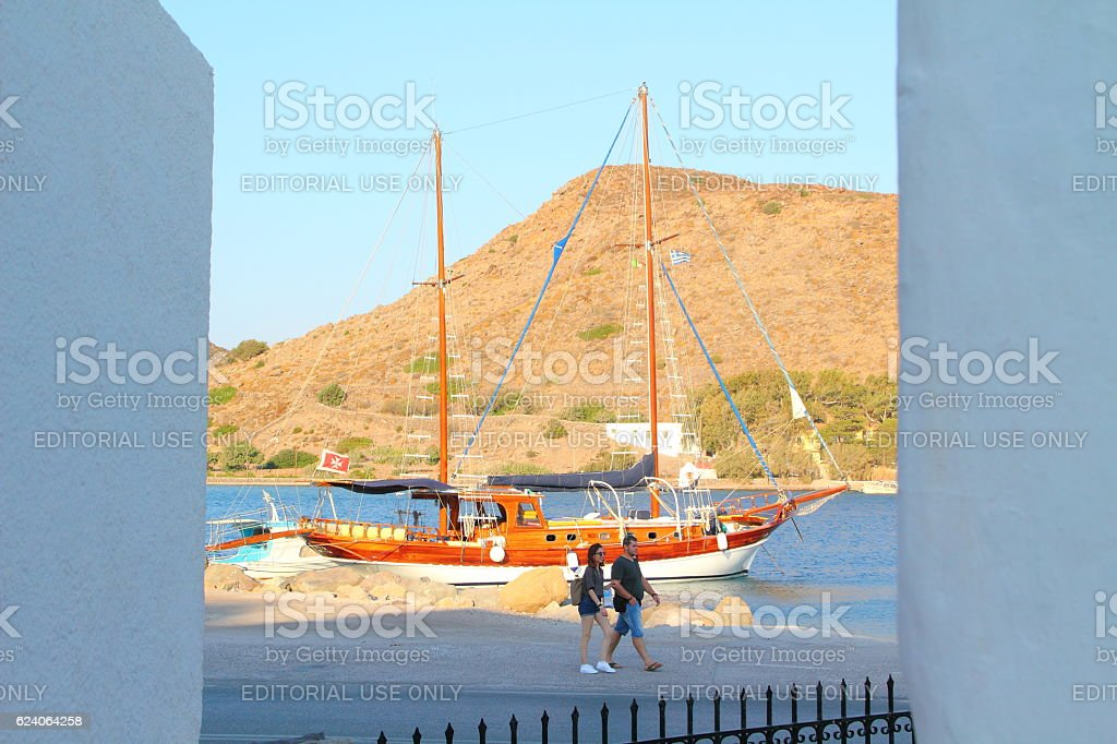 boat in the port of patmos stock photo