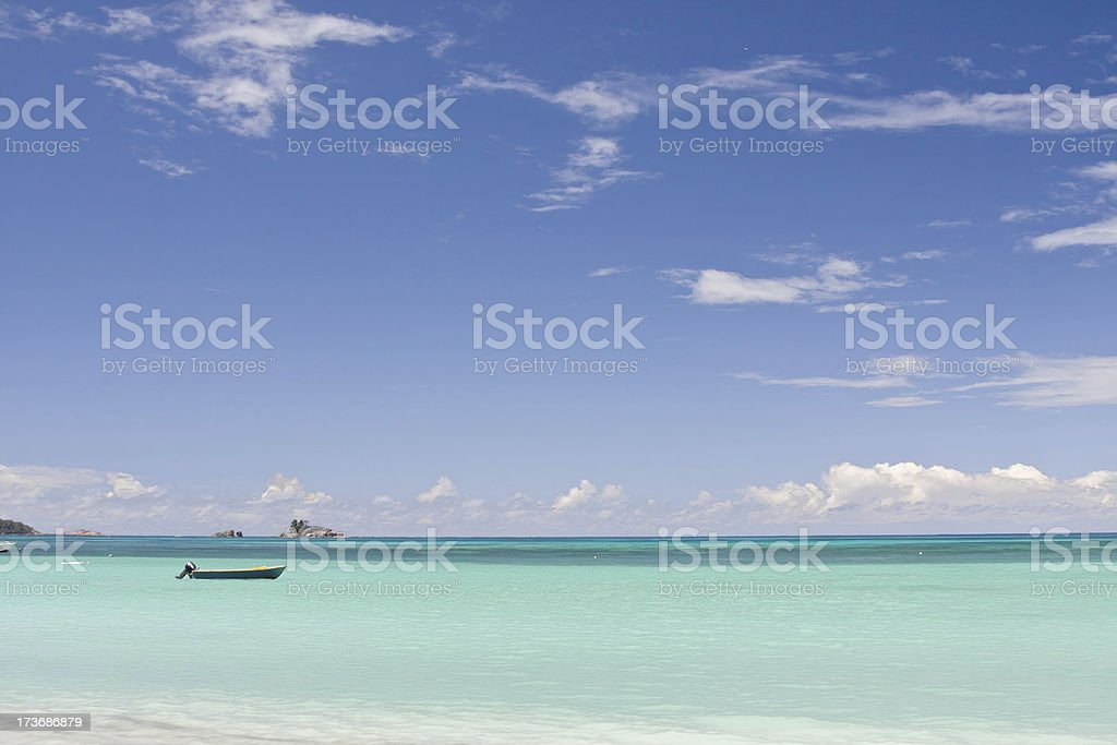 boat in tropical lagoon stock photo