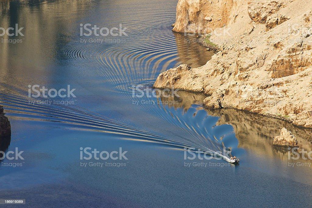 Boat leaving waves in Zrmanja river canyon stock photo