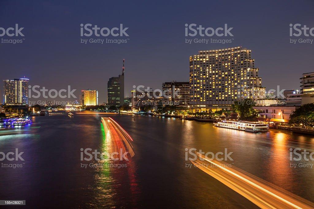 Boat light trails on Bangkok Chao Phraya river stock photo