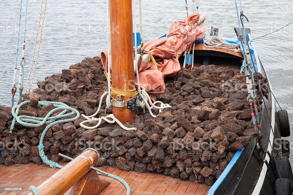 Boat loaded with turf stock photo