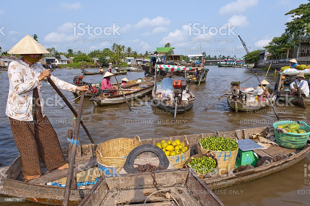 Boat loaded with vegetables and fruits in floating market stock photo