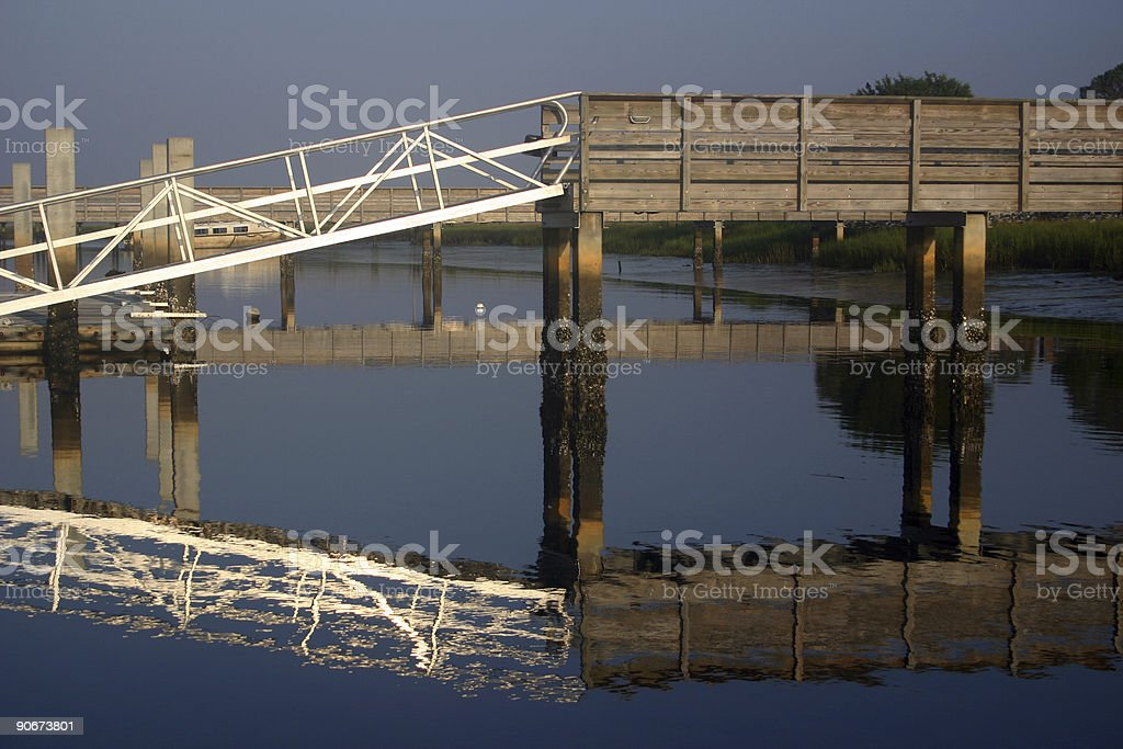 boat loading dock with reflection stock photo