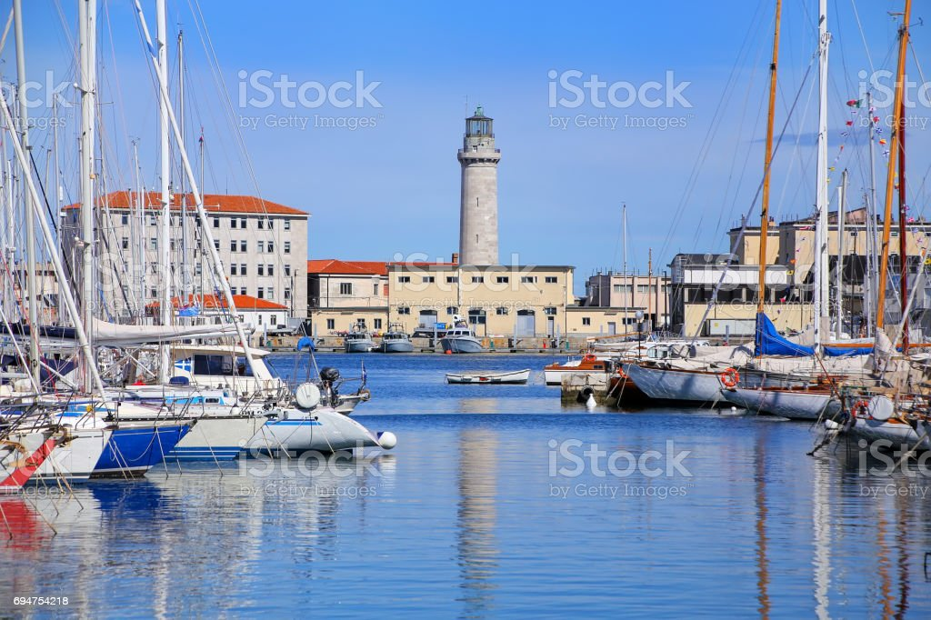 Boat marina and lighthouse in Trieste, Italy stock photo
