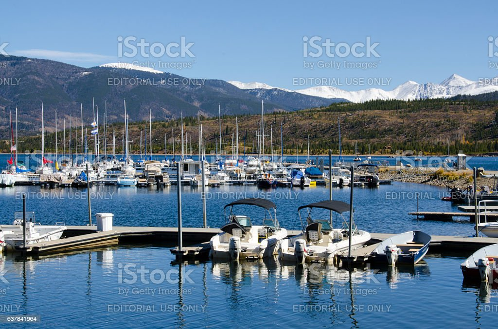 Boat Marina with Snow on the Mountains stock photo