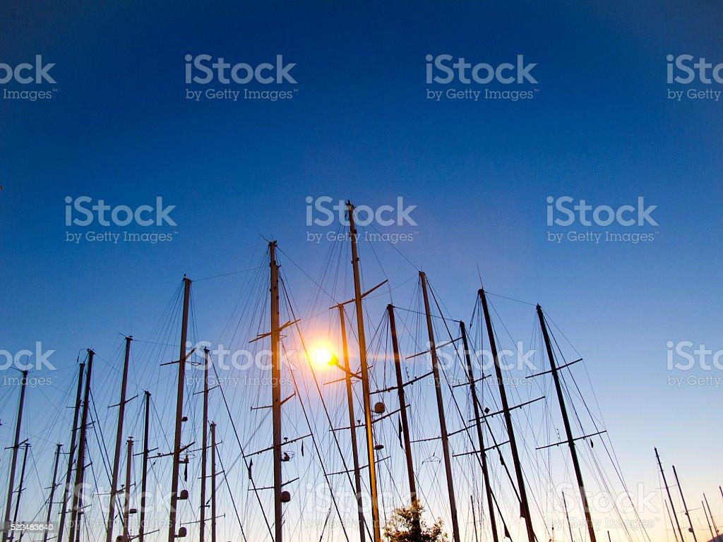 Boat mast at sunset stock photo