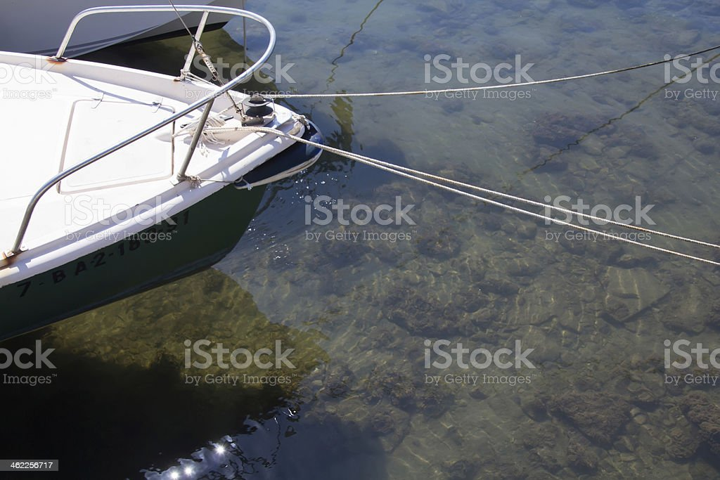 boat moored at the port with clear water royalty-free stock photo