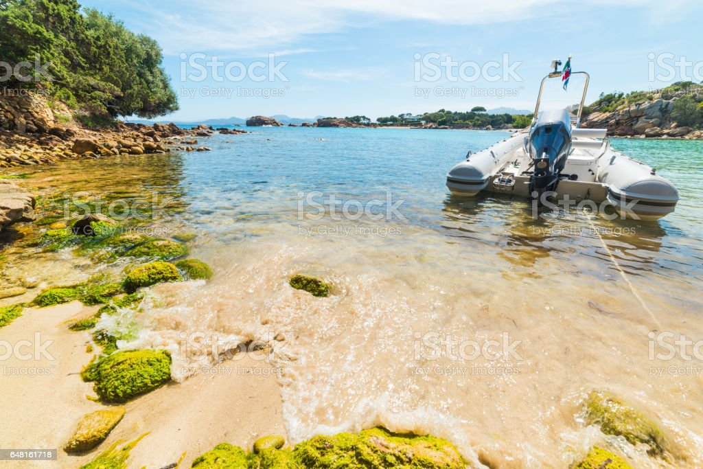 boat moored in a small cove stock photo