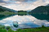 Boat moored in an alpine lake in Switzerland
