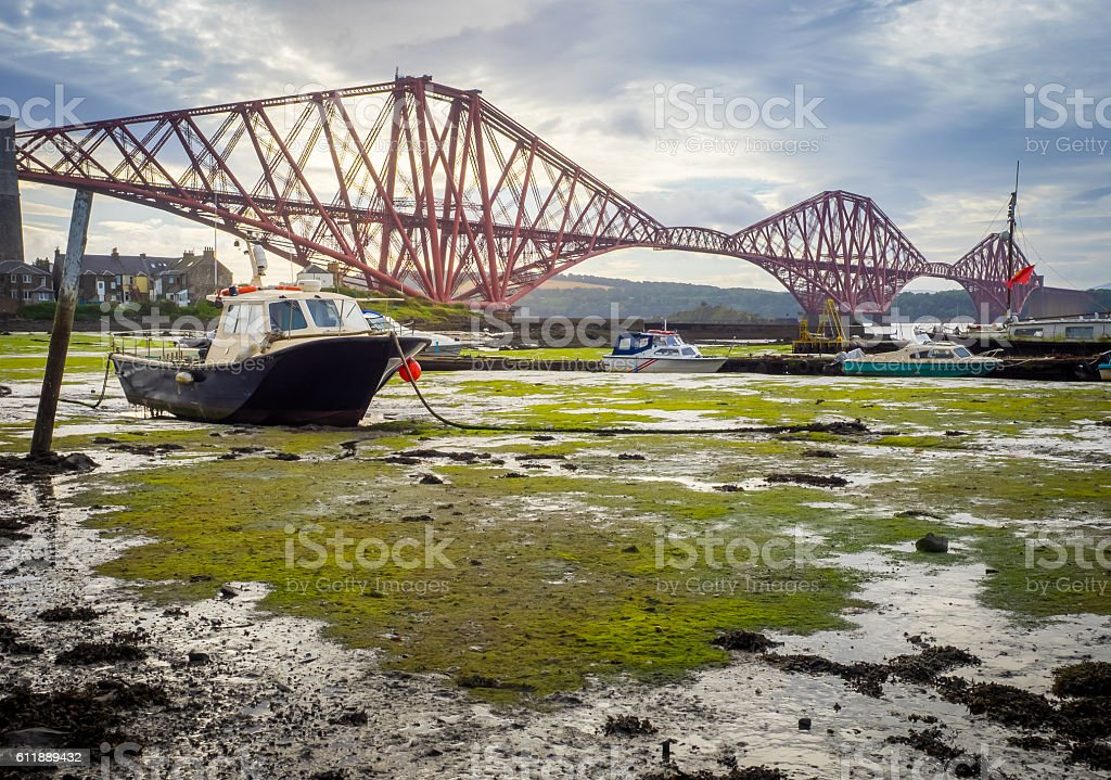 Boat moored in front of the Forth Rail Bridge stock photo