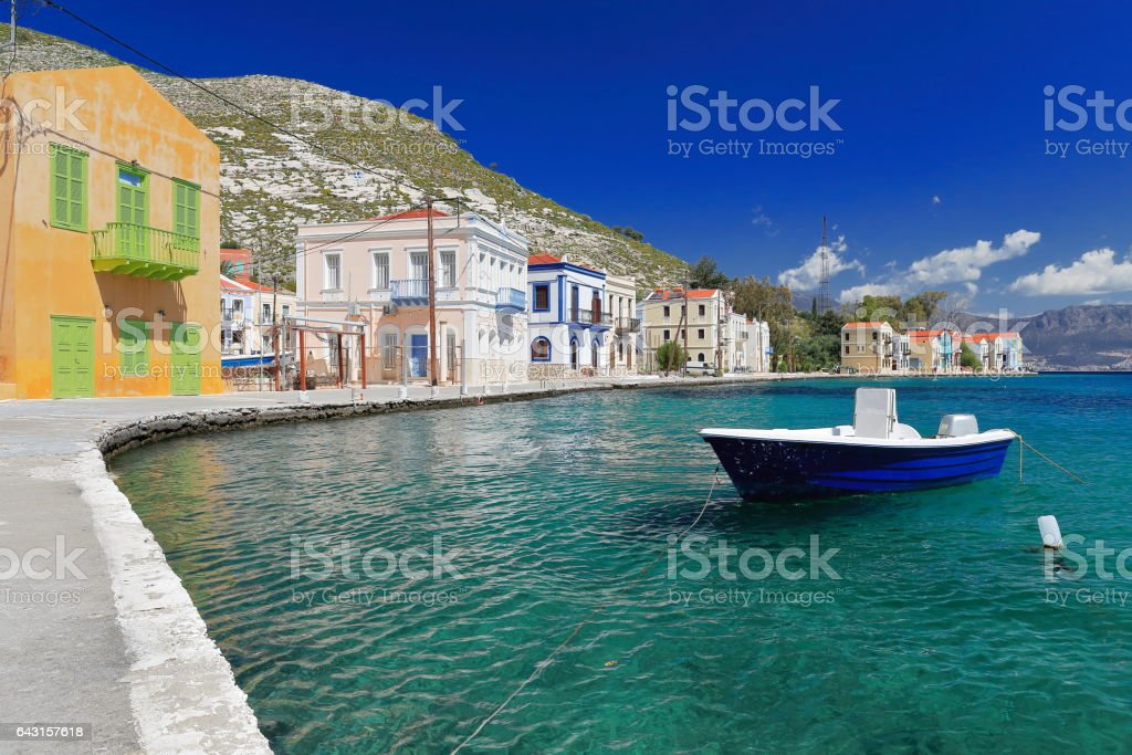 Boat moored-west side main harbor-Pera Meria district. Kastellorizo-Greece. 1606 stock photo