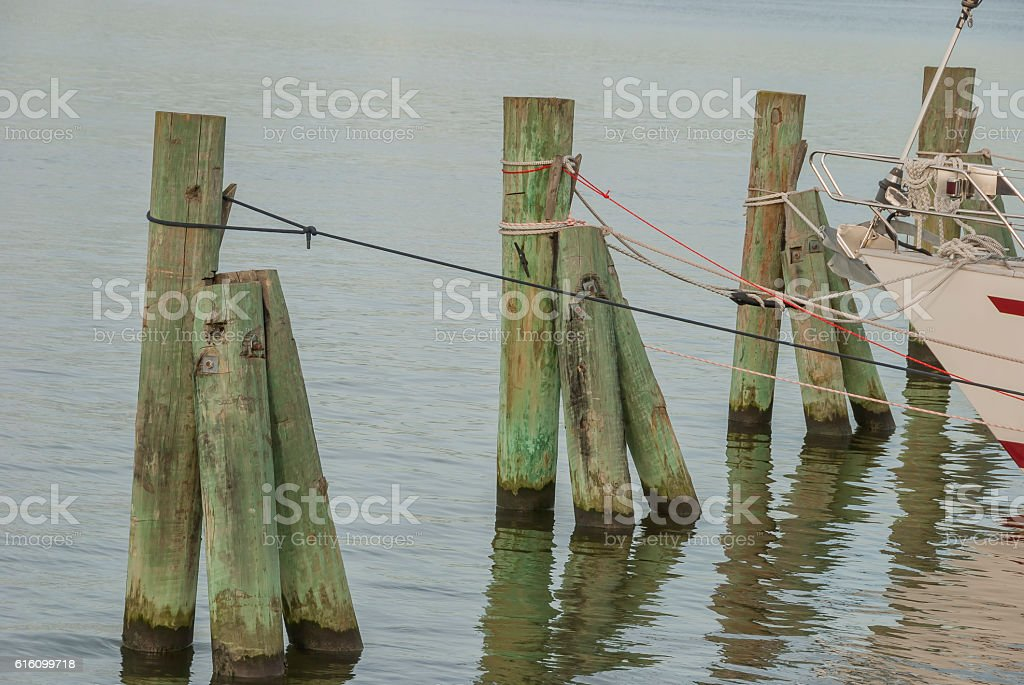 Boat mooring in a row by the sea stock photo