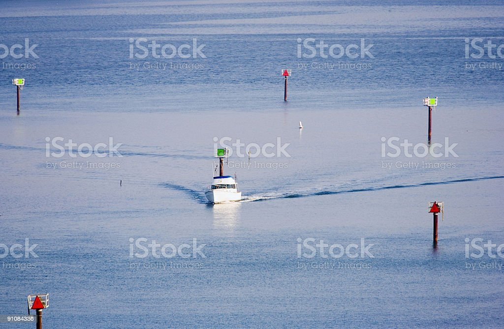 Boat Navigating Channel Marker Buoys royalty-free stock photo