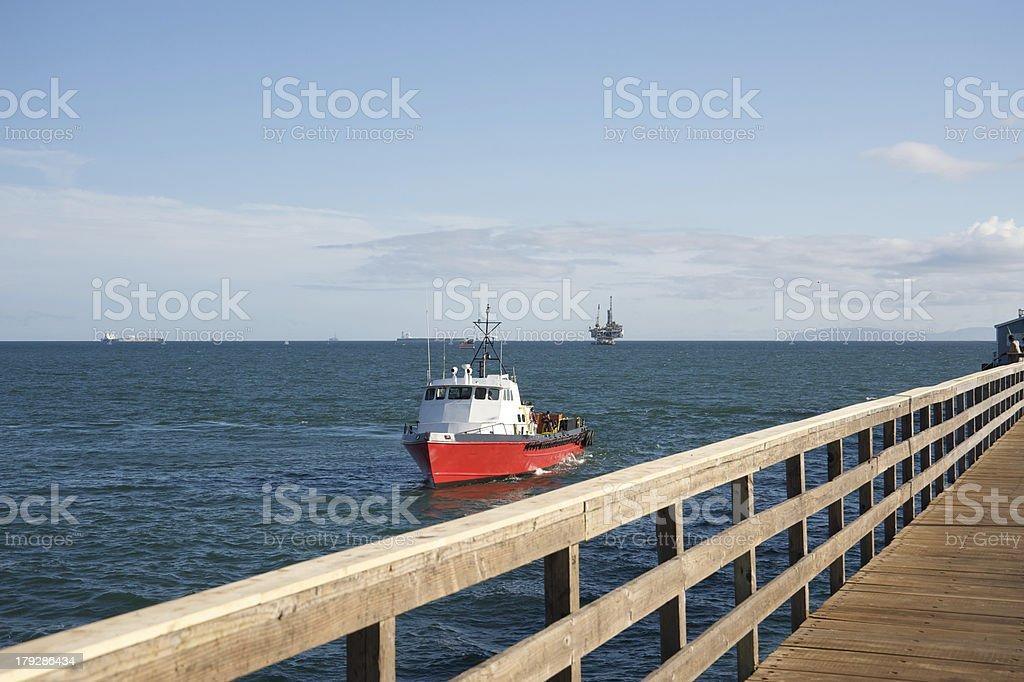 Boat near pier royalty-free stock photo