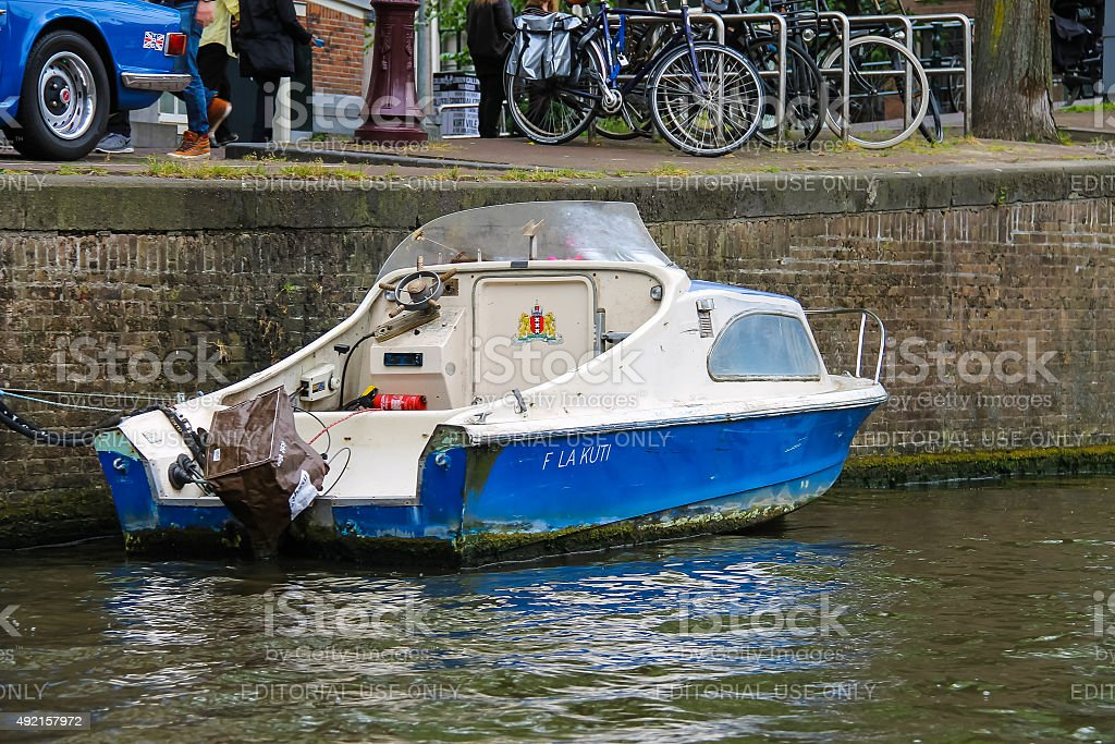 Boat near the waterfront canal in Amsterdam stock photo