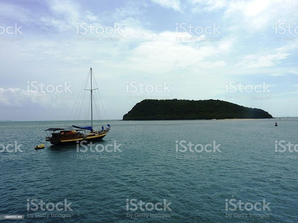 Boat next to an Island in Thailand royalty-free stock photo