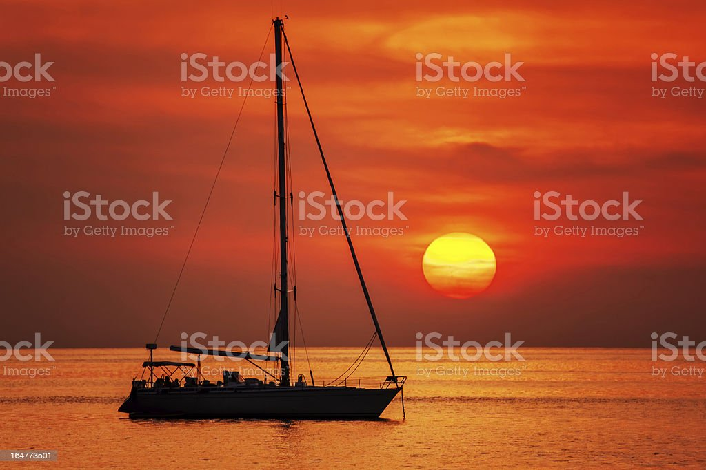 boat on a background of  beautiful sunset royalty-free stock photo