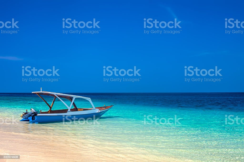 boat on a beautiful tropical beach stock photo
