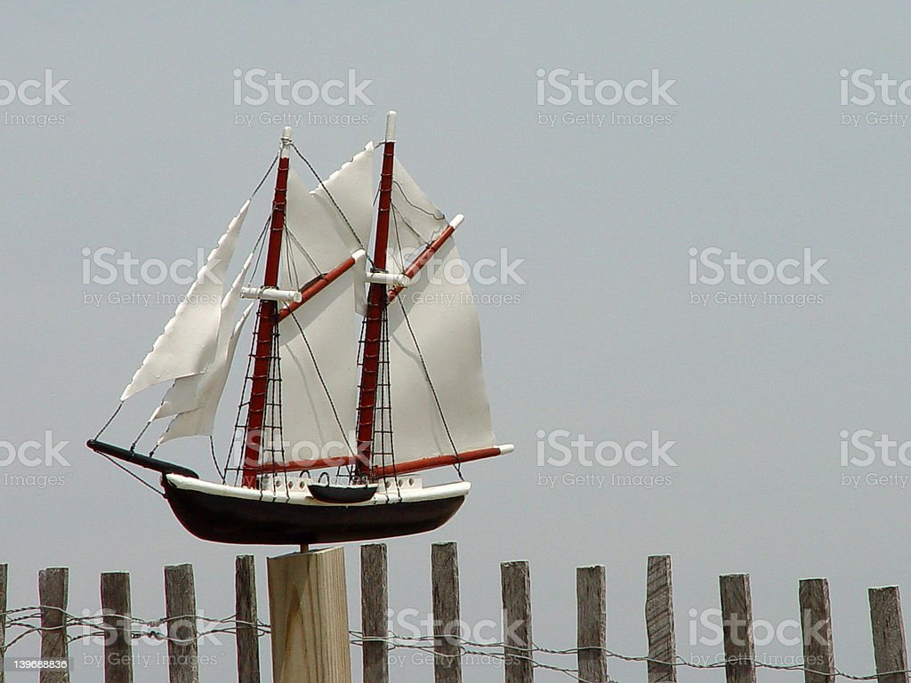 Boat on a fence stock photo