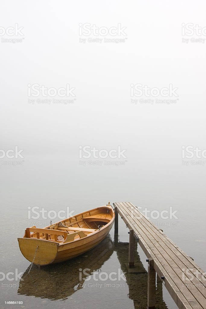 Boat on a misty morning royalty-free stock photo