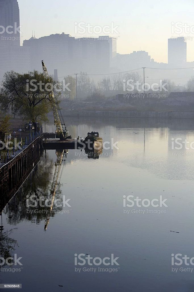 Boat on a River with Cleveland Skyline stock photo