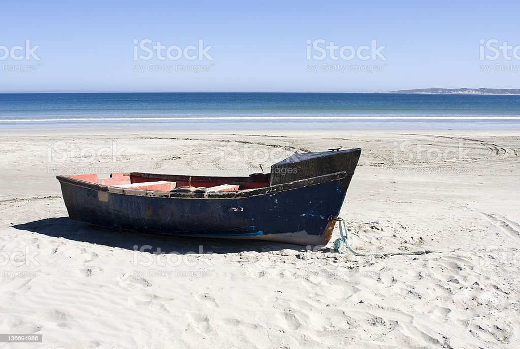 Boat on a secluded beach in Paternoster, South Africa stock photo
