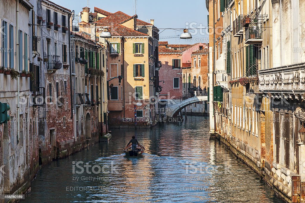 Boat on a Venetian Canal royalty-free stock photo