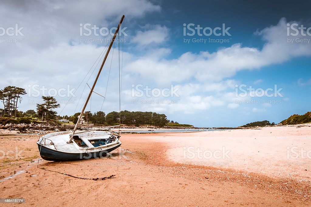 boat on  Beach in Brittany stock photo