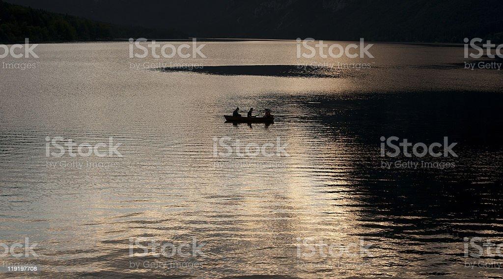 Boat on Bohinj lake Slovenia at sunset royalty-free stock photo