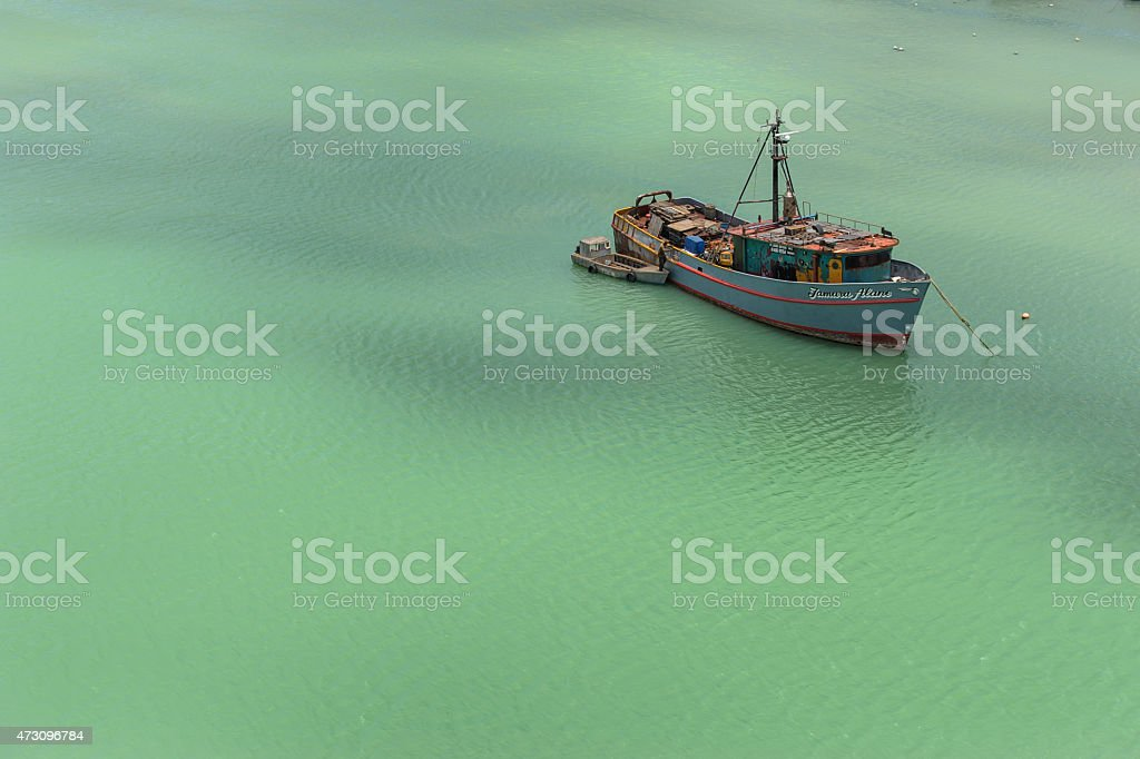Boat on emerald ocean royalty-free stock photo