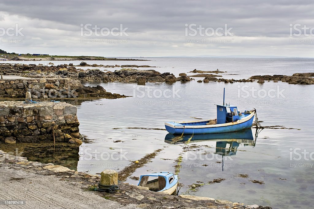 Boat on Galway Bay stock photo