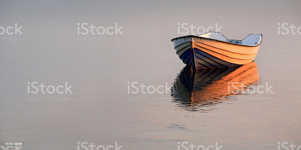 Boat on Lake at Sunset stock photo