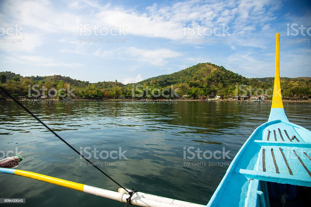Boat on Lake Taal Approaching Shore stock photo