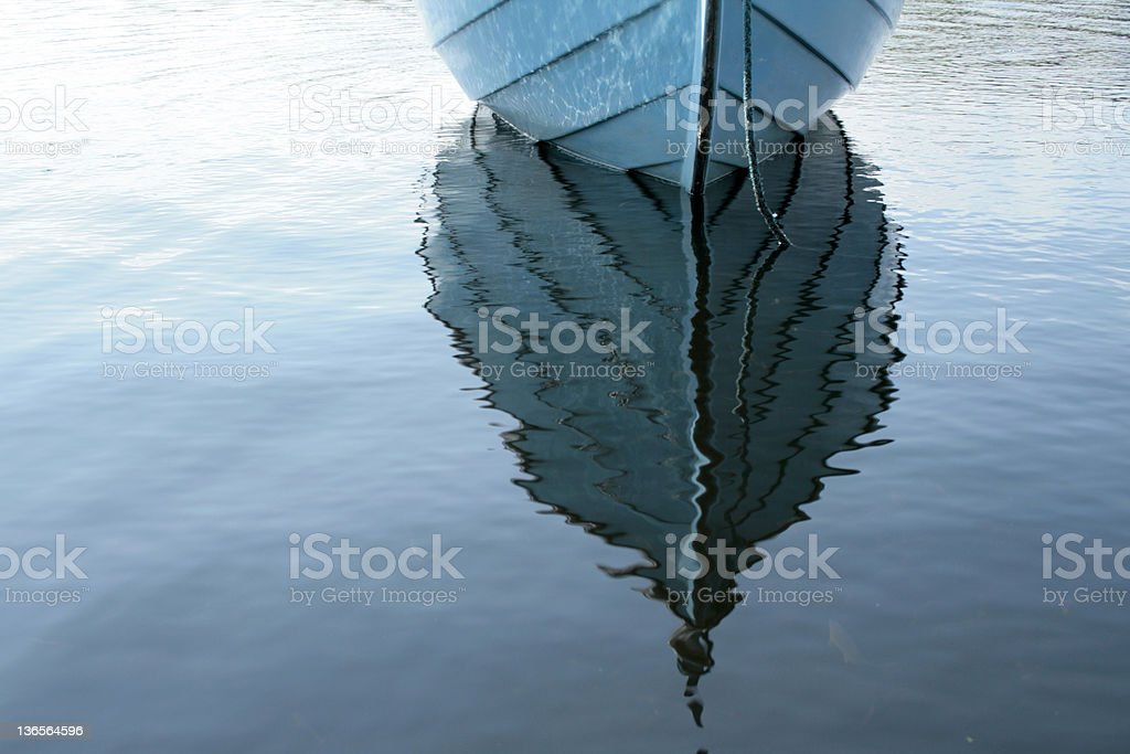 Boat on lake, with water reflection royalty-free stock photo