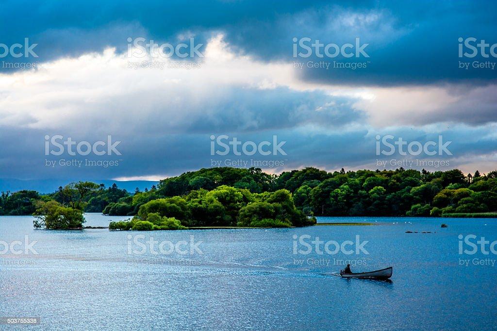 Boat on Lough Leane in Killarney National Park in Ireland stock photo