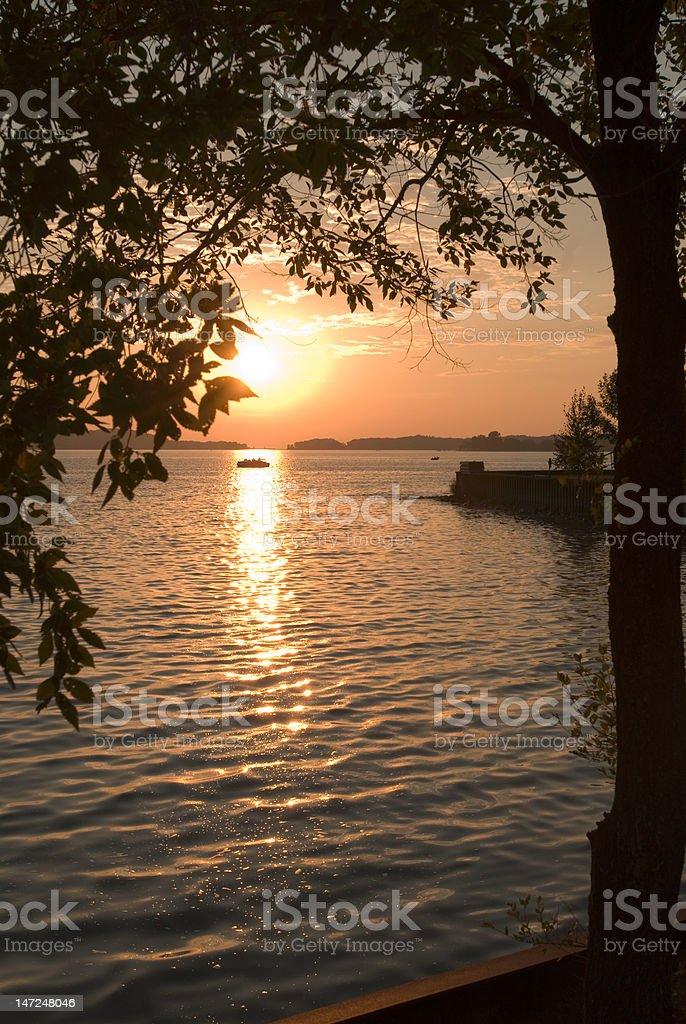Boat on Portage Lake at Sunset stock photo