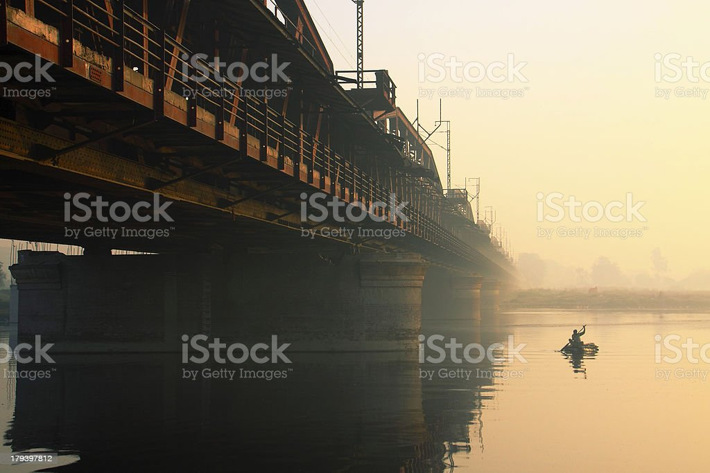 Boat on River and a Old Iron Bridge stock photo