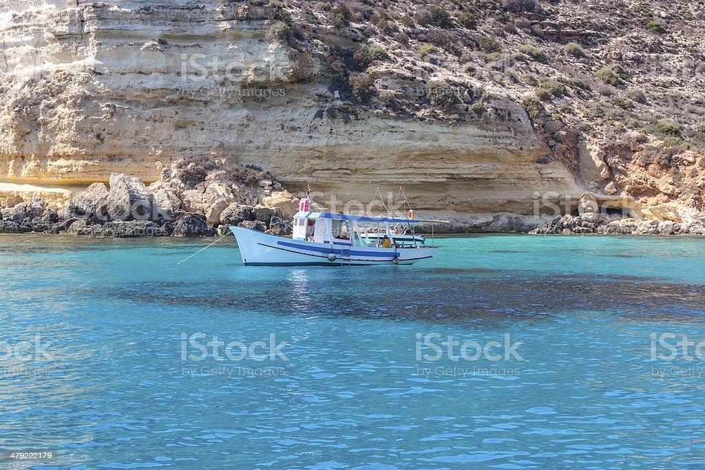 boat on sea of Lampedusa stock photo
