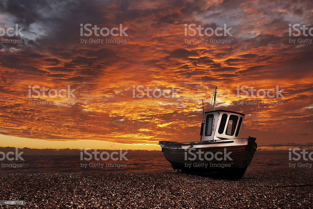 Boat on Shore at Sunset royalty-free stock photo