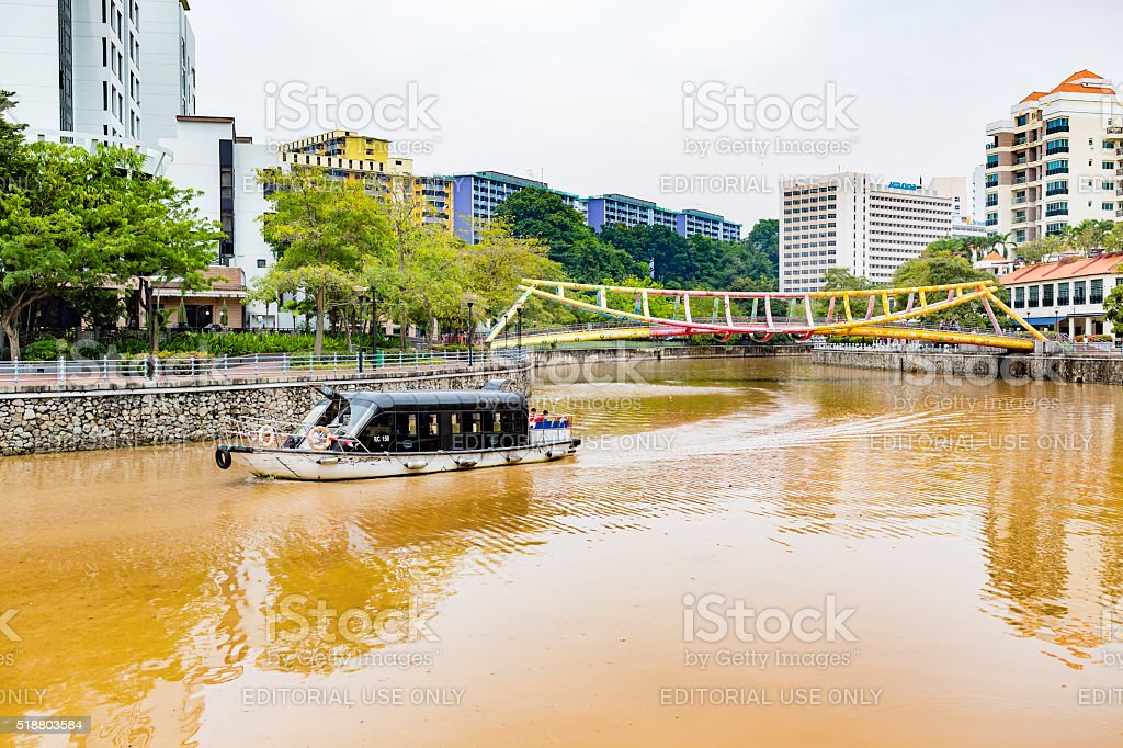 Boat on Singapore River With the Rainbow Alkaff Bridge stock photo
