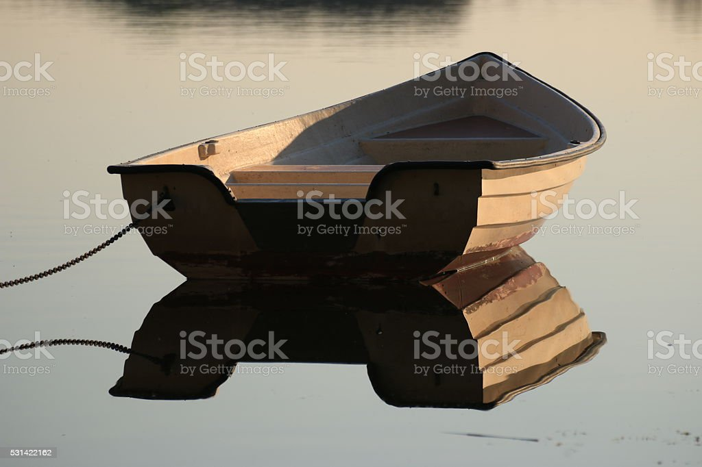 Boat on still water stock photo