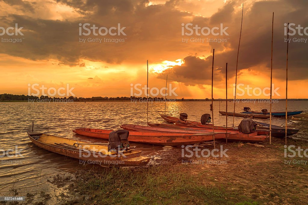 Boat on sunset background stock photo