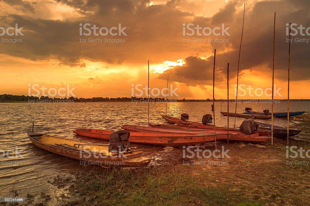 Boat on sunset background stock photo